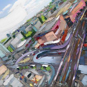 Ein Foto, bunt bemalt, man sieht eine Stadt aus der Vogelperspektive, im Hintergrund den Himmel